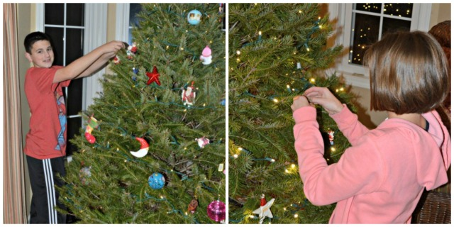 Peter and Emma putting ornaments on the tree web 2013
