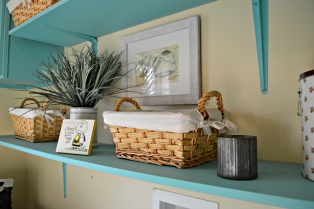 the plant and picture in laundry room web