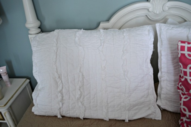 white ruffle pillow guest room